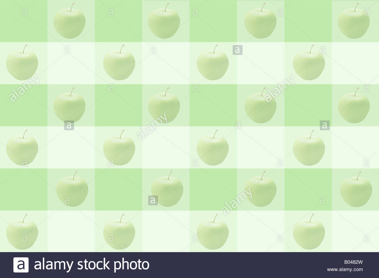 Apples on a checker pattern - Stock Image