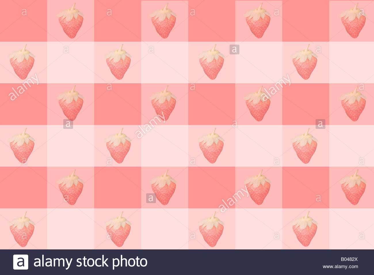 Strawberries on a checker pattern - Stock Image