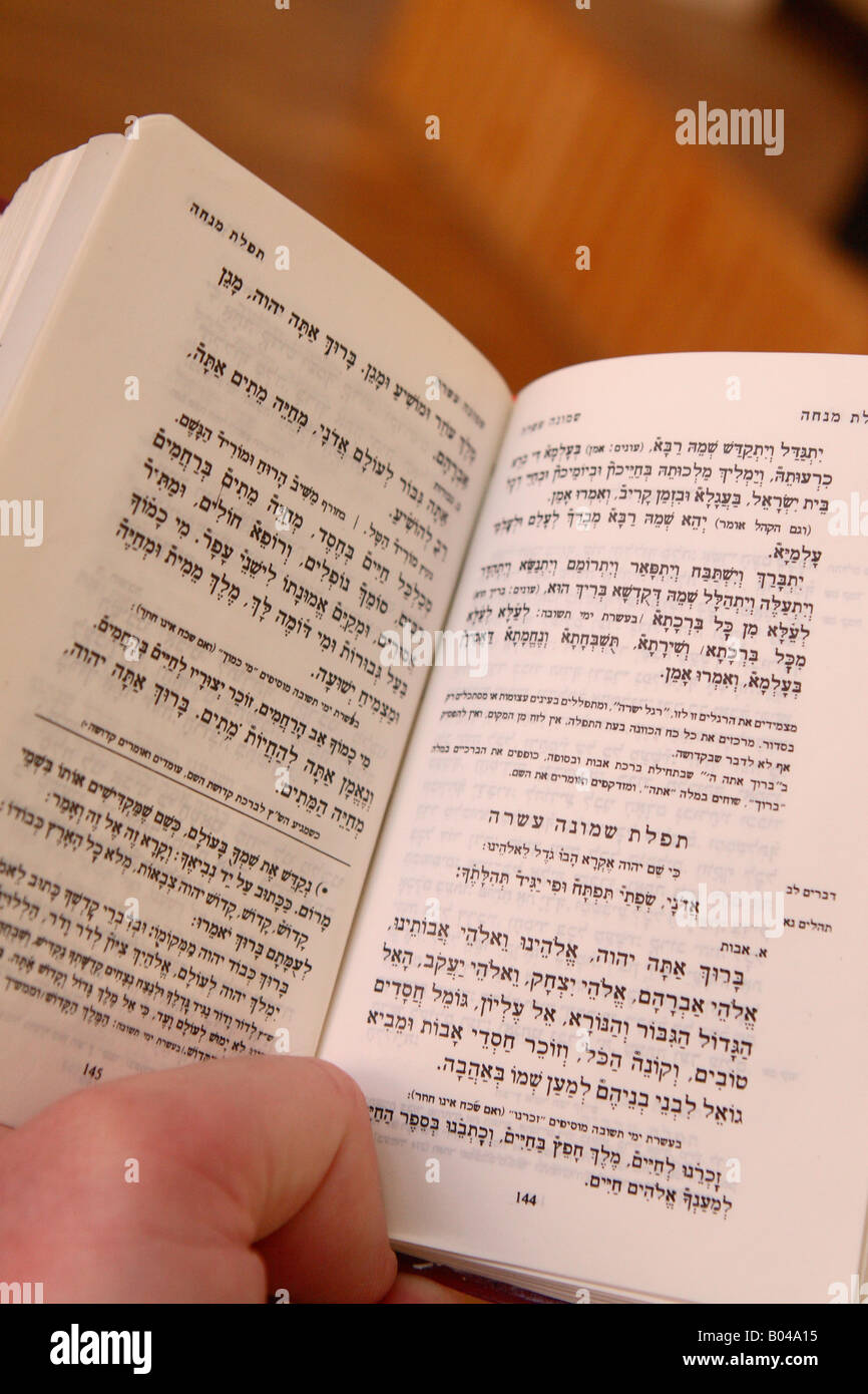 Jewish religion book of prayer with Hebrew language text - Stock Image