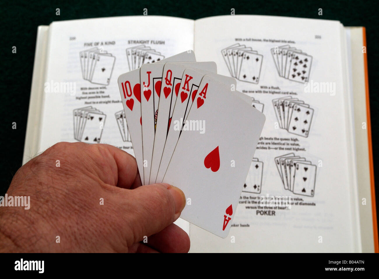 Playing Cards Learning to Play Hand holding a royal flush the ...