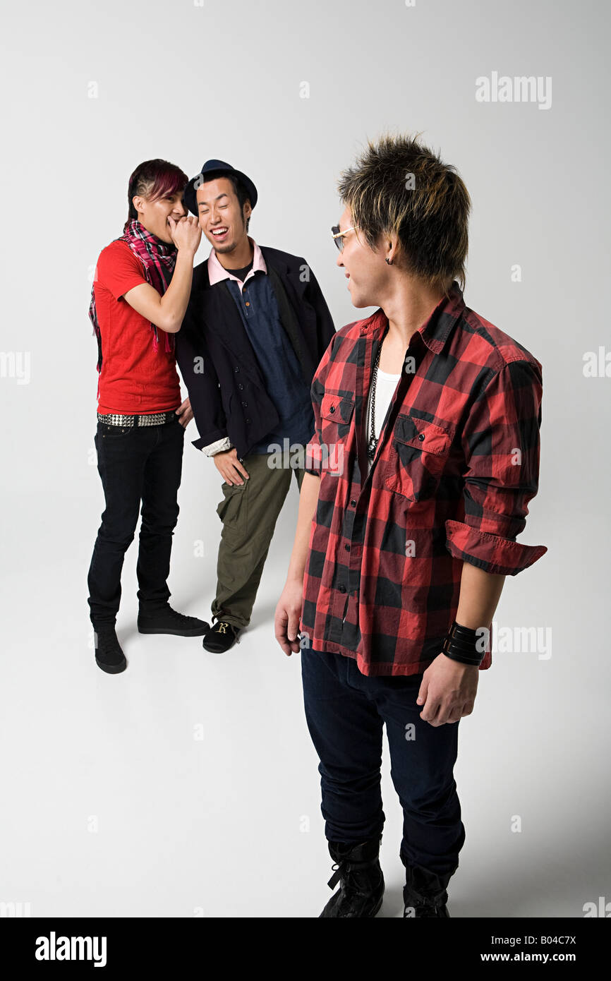 Japanese youths joking around - Stock Image
