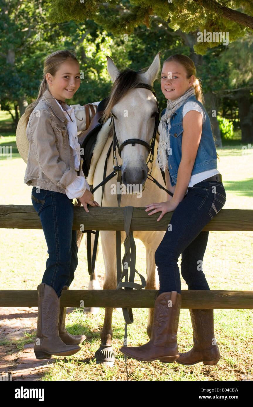 Portrait of two girls and a horse - Stock Image