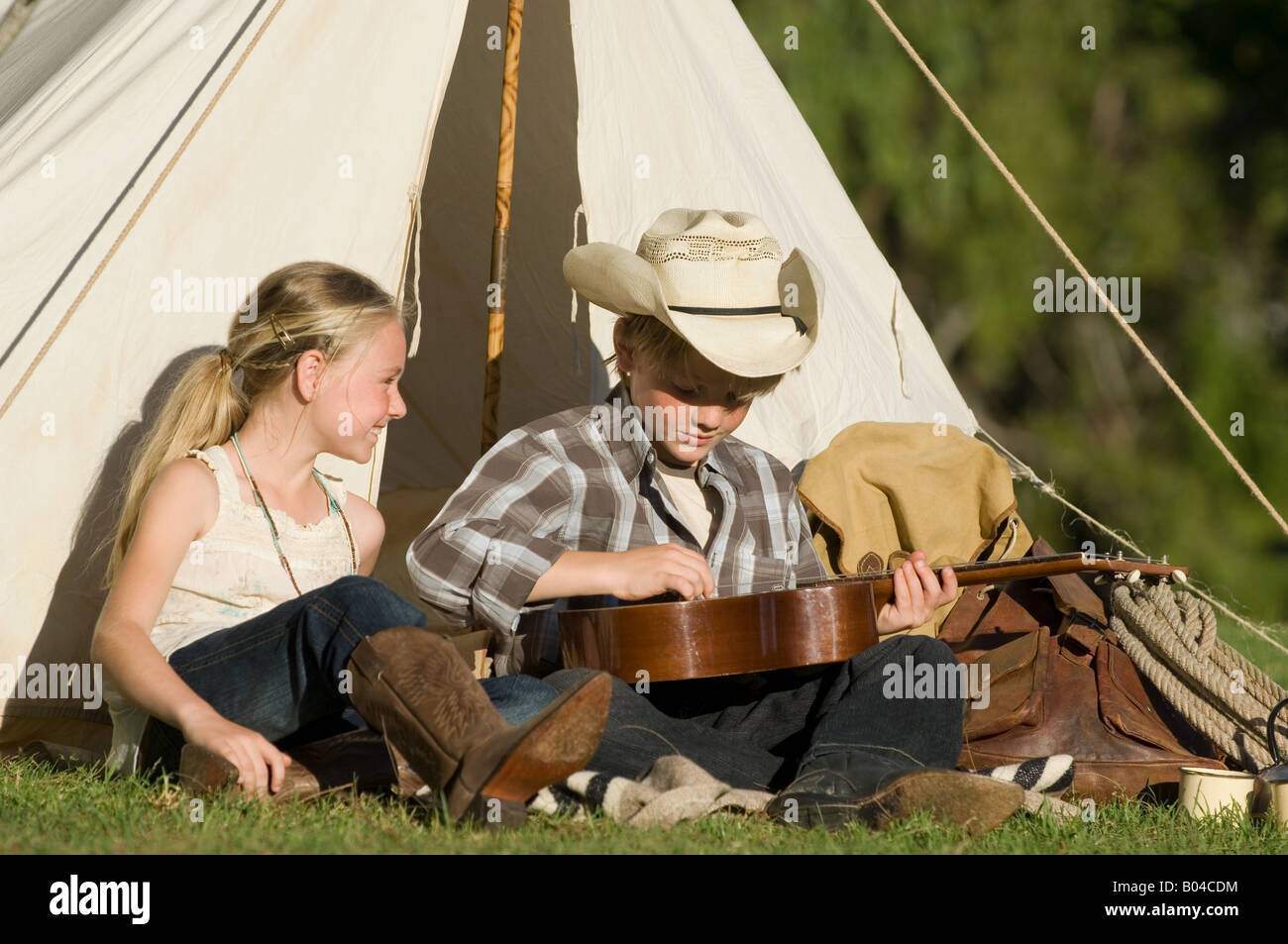 A boy playing a guitar - Stock Image