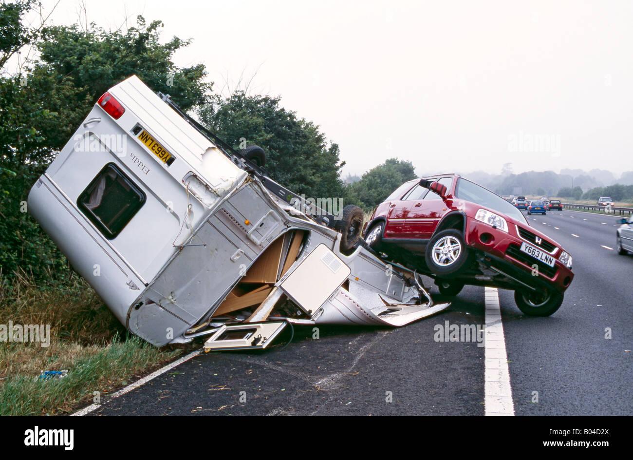 nasty caravan crash on a british motorway - Stock Image