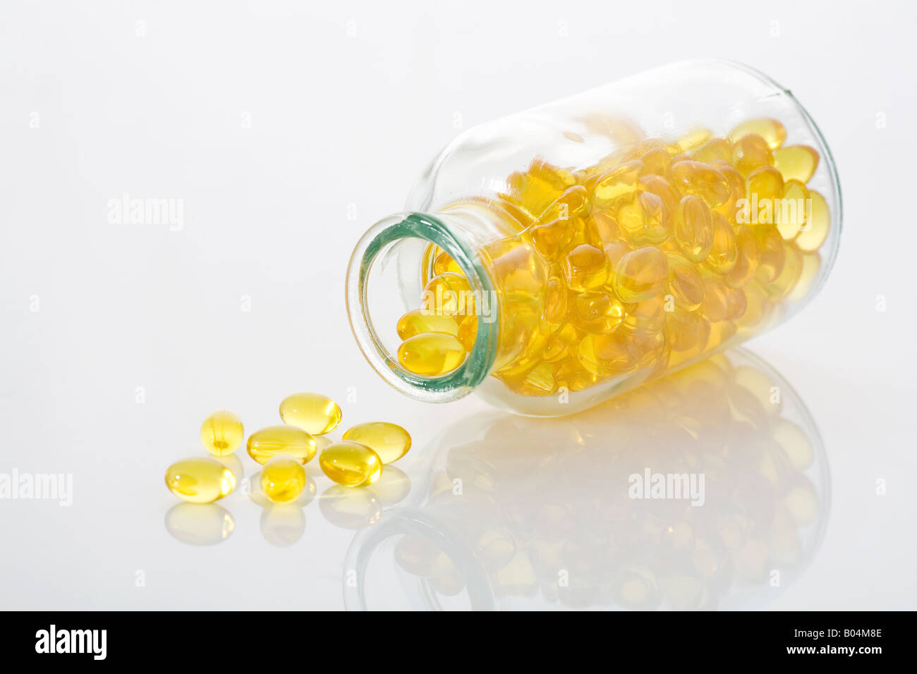 Fish oil pills in clear glass bottle. Stock Photo