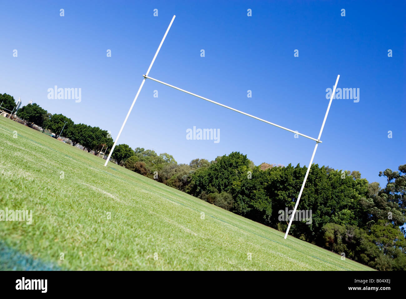 Looking up towards rugby posts. Composed on an angle to give a dynamic, in the heart of the action look. - Stock Image