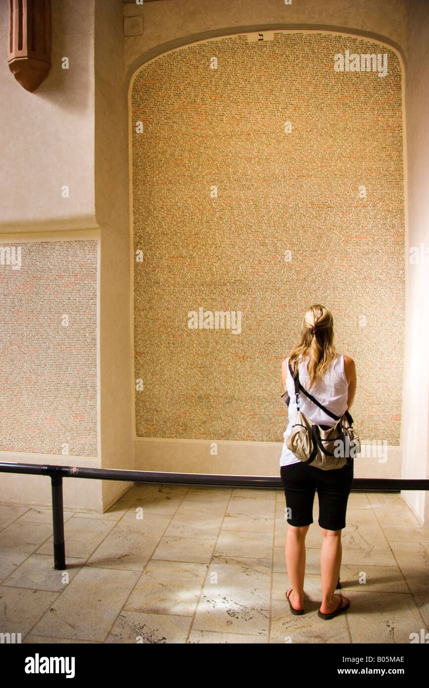 Woman looks at names of War dead Pinkas Synagogue Jewish Quarter Prague Czech Republic - Stock Image