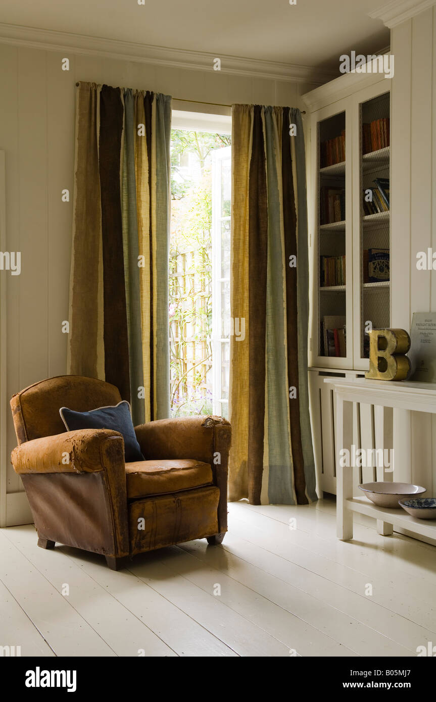 Distressed Leather Armchair With Curtains, Fabric By Jim Thompson