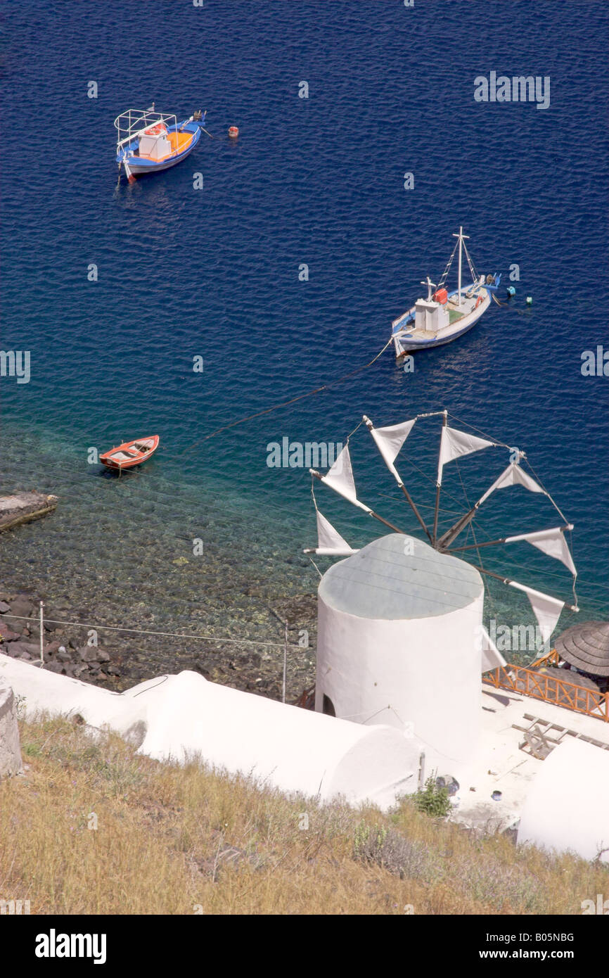 A Greek Windmill On The Sea Shore - Stock Image