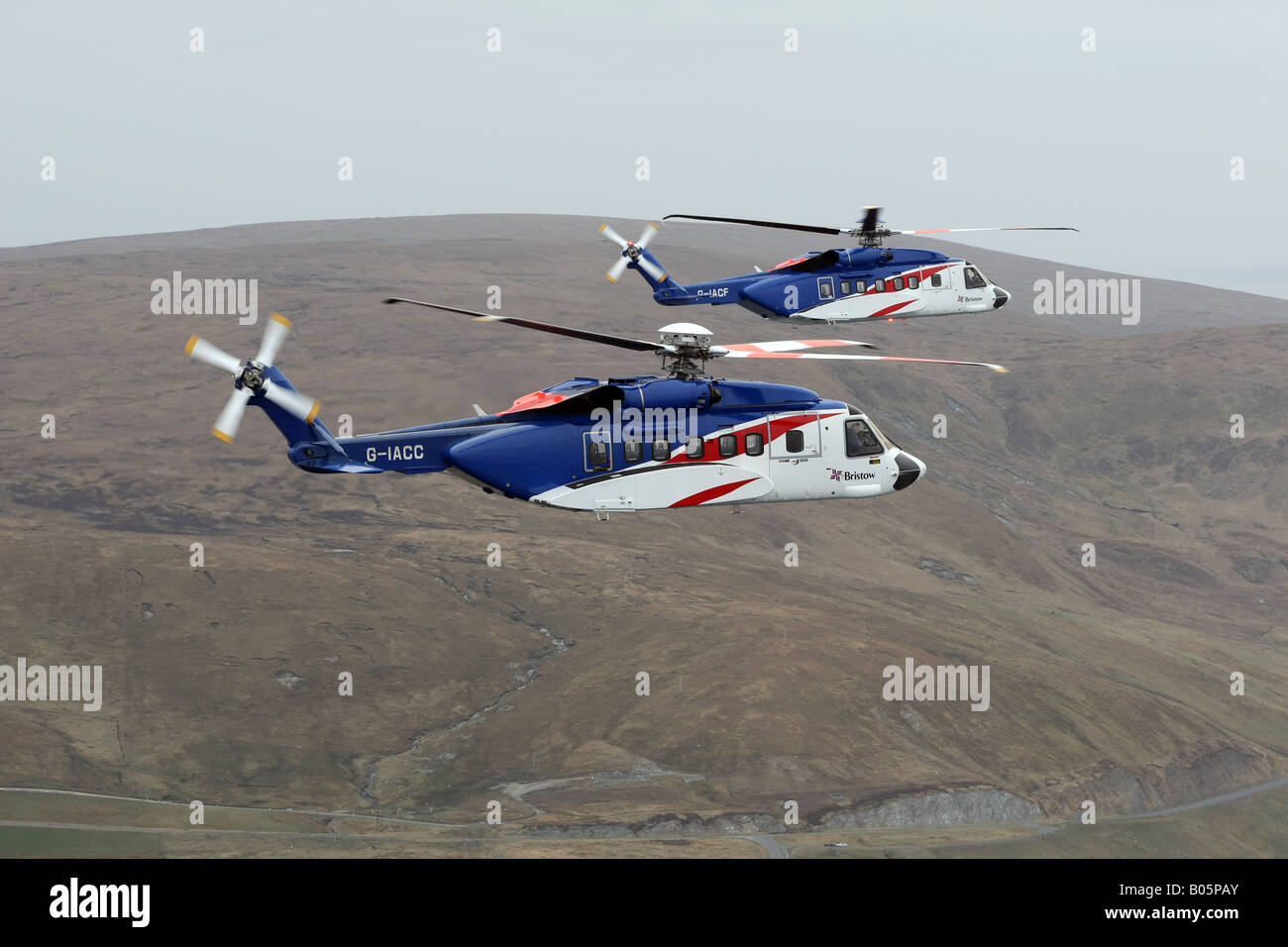Bristows Sikorsky S-92 Helicopters from Scatsta to transport offshore oil workers pictured flying over Shetland - Stock Image