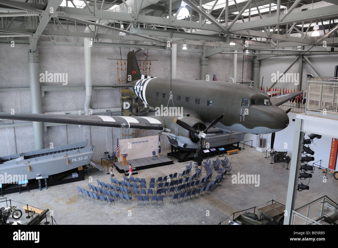A C47 airplane hangs in the entrance hall of the National World War II museum in New Orleans. - Stock Image