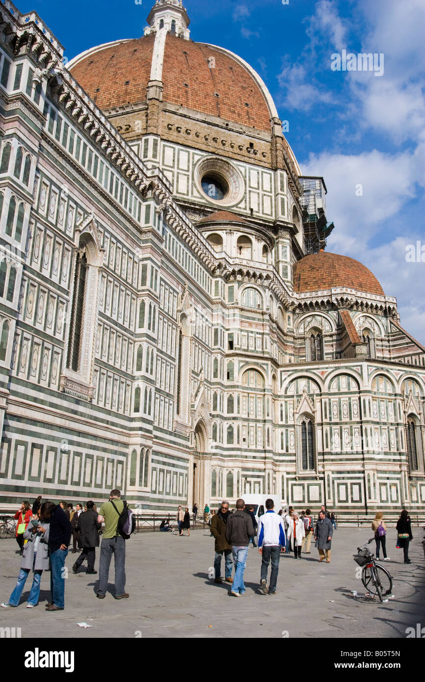 Side view of il Duomo in Florence with red tiled roof of dome against blue sky - Stock Image