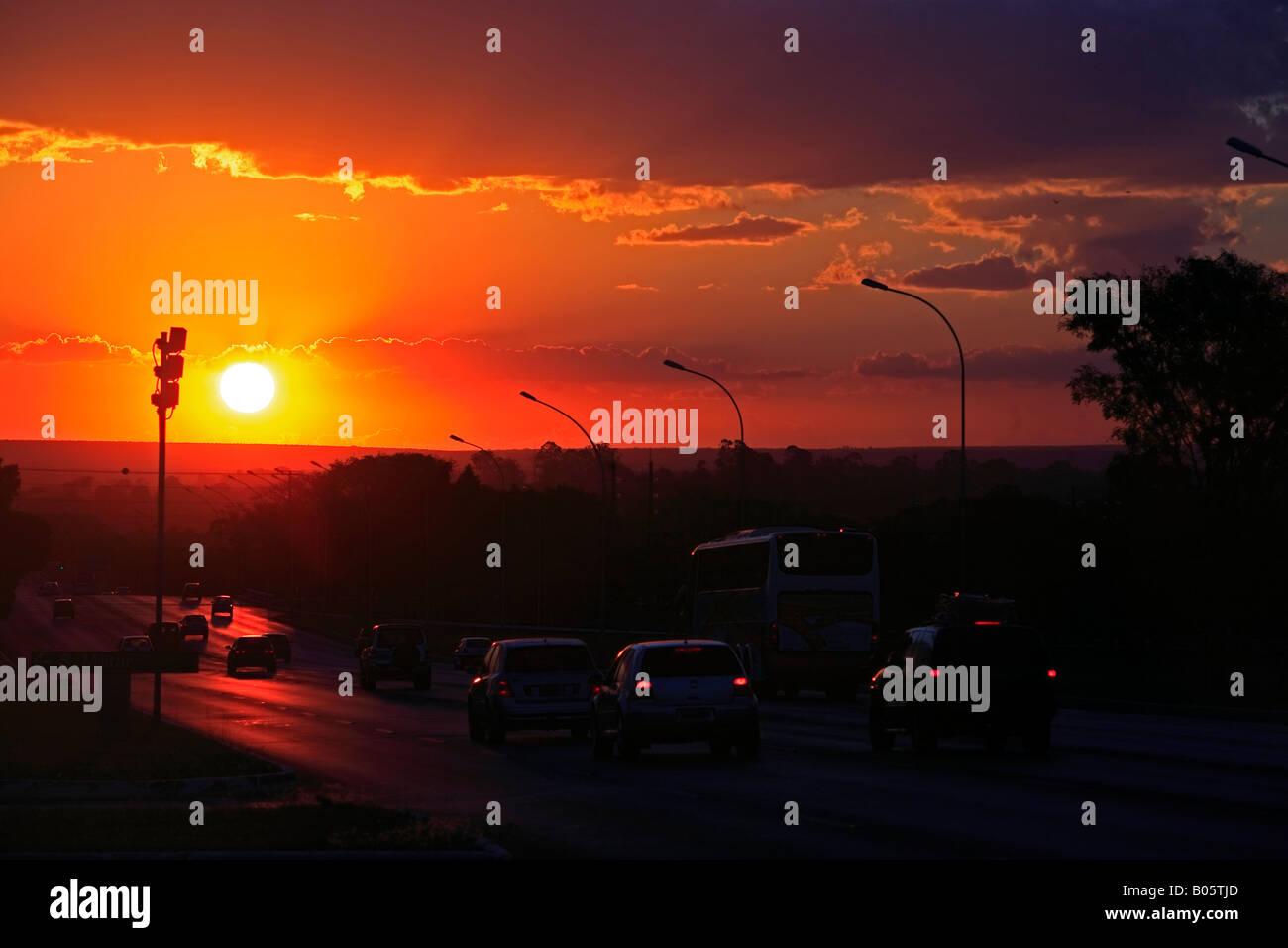 traffic at sunset in  Brasilia city capital of Brazil - Stock Image