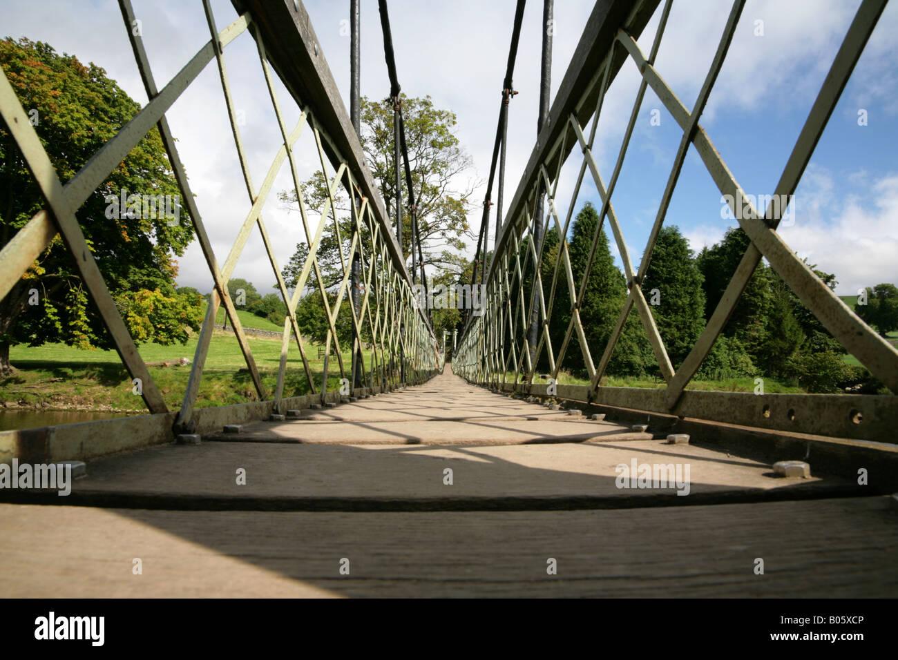 Suspension footbridge over the River Wharfe near Hebden, Yorkshire Dales. Stock Photo