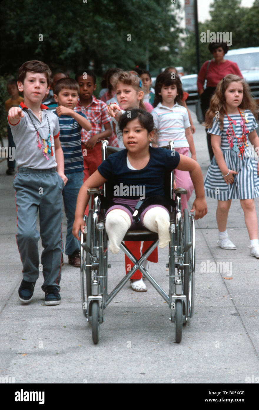 Mainstreamed disabled child on a field trip with her classmates in Brooklyn, New York - Stock Image