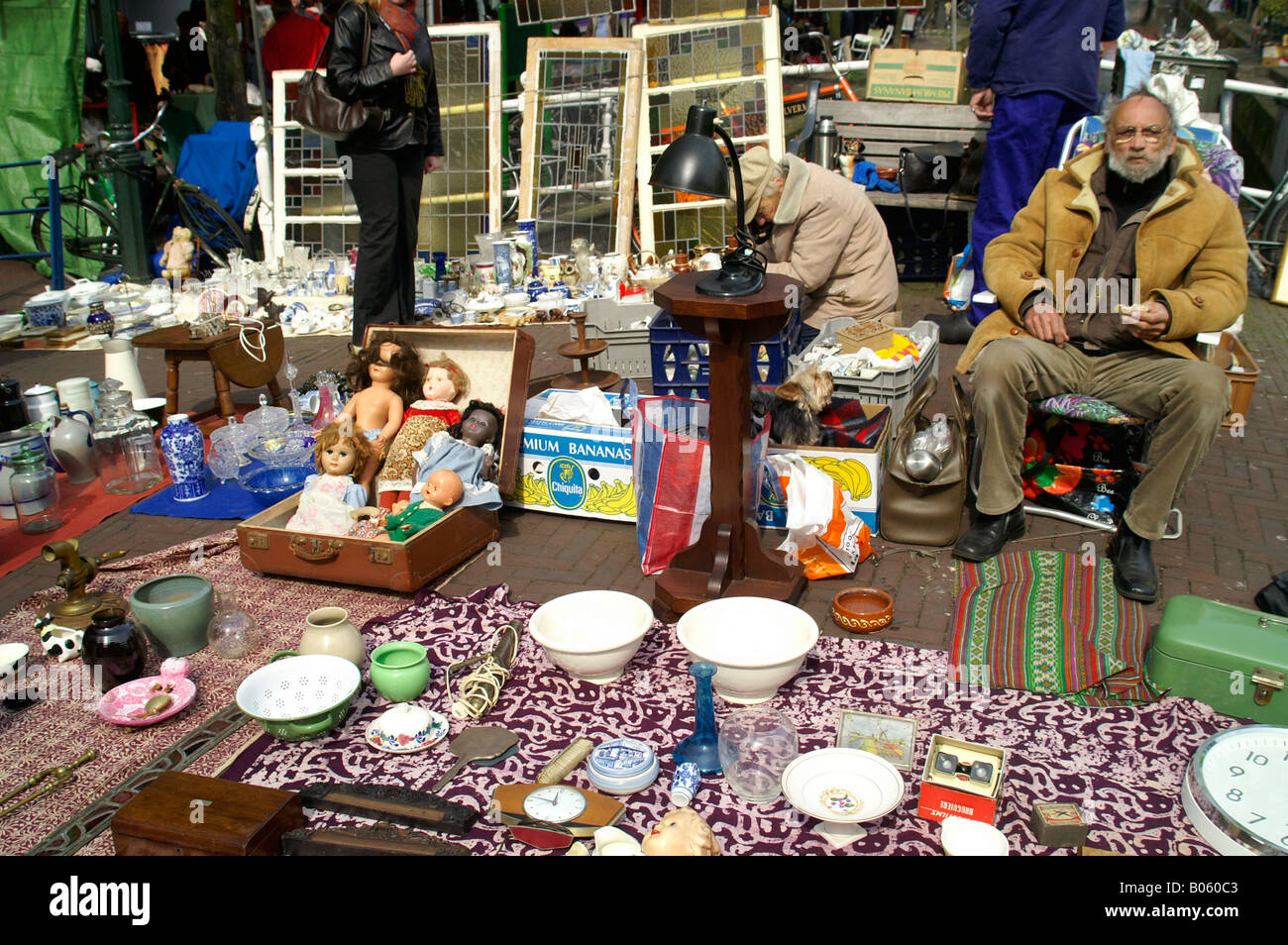 Traditional flea market in Delf city historic center man selling antiques collectables on street, Netherlands - Stock Image