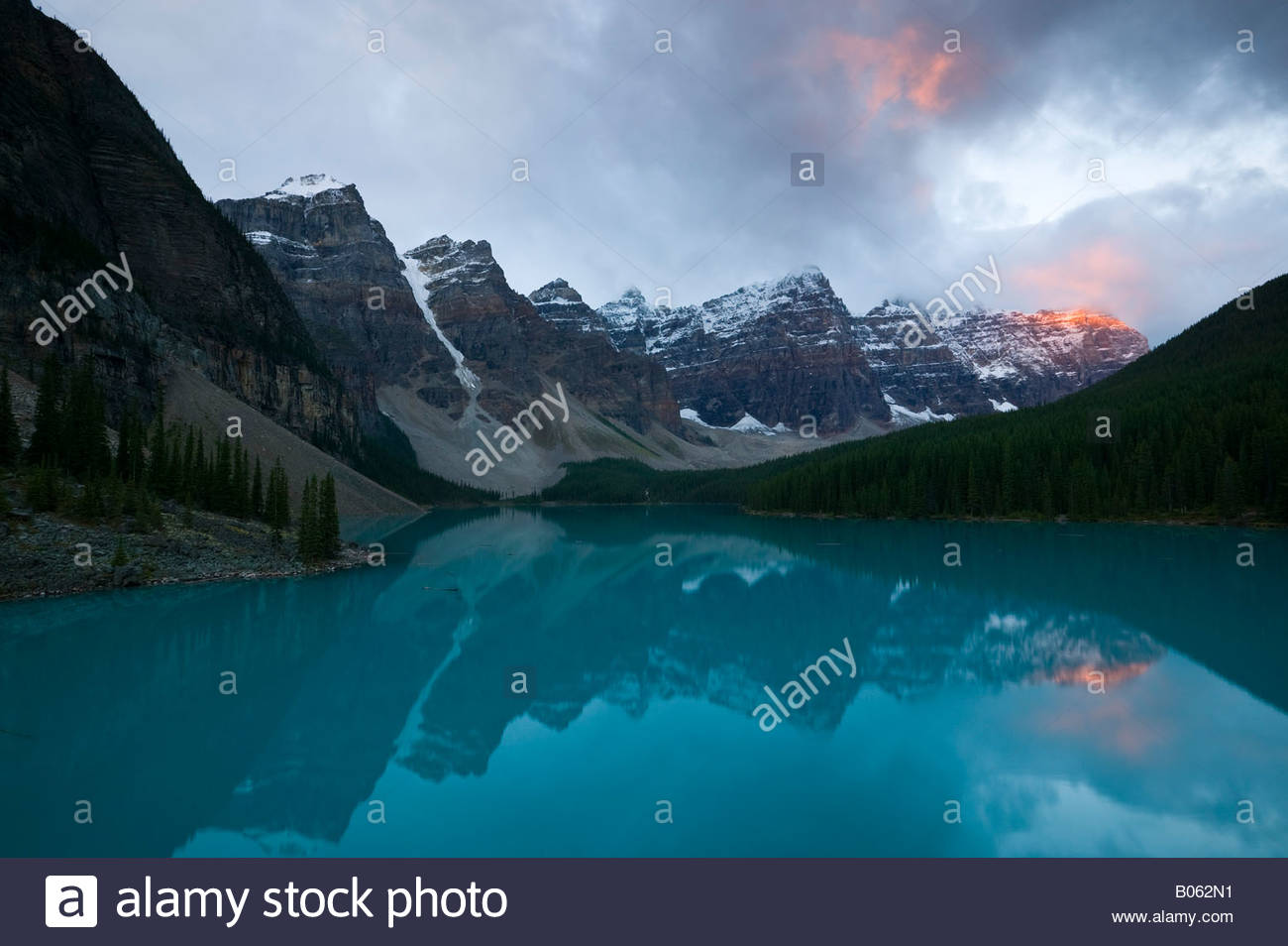 Several mountains in the Canadian Rockies tower over Moraine Lake located in Banff National Park. - Stock Image