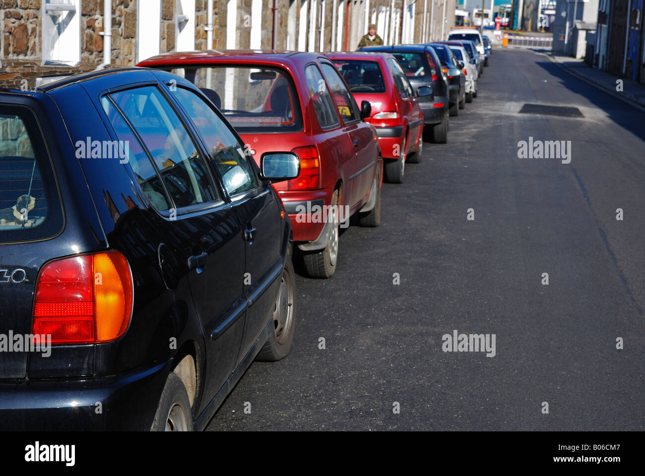 a row of parked cars in a narrow street in camborne,cornwall,england - Stock Image