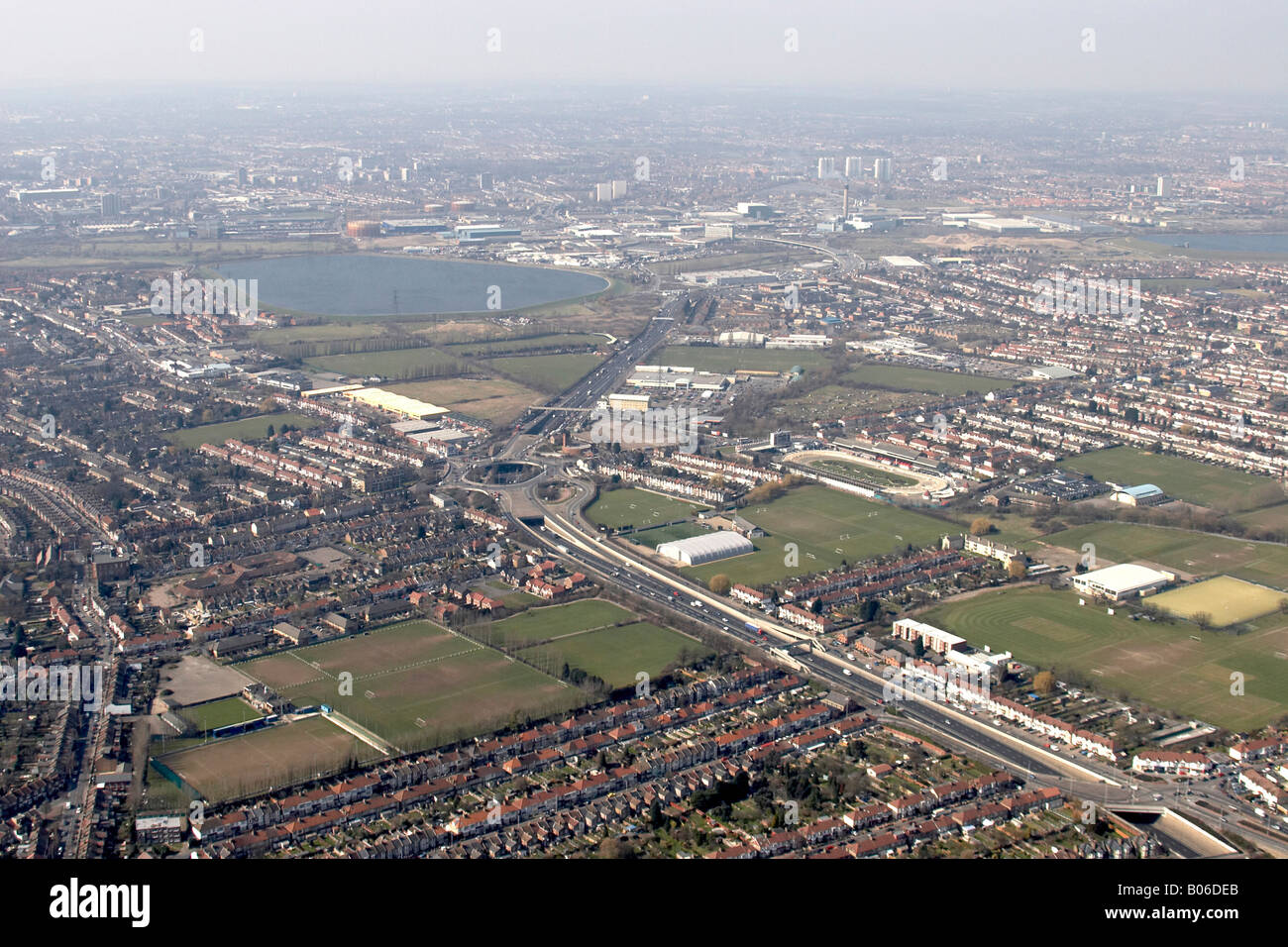 Aerial view north west of Crooked Billet A406 Banbury Reservoir Walthamstow Greyhound race track suburban houses - Stock Image