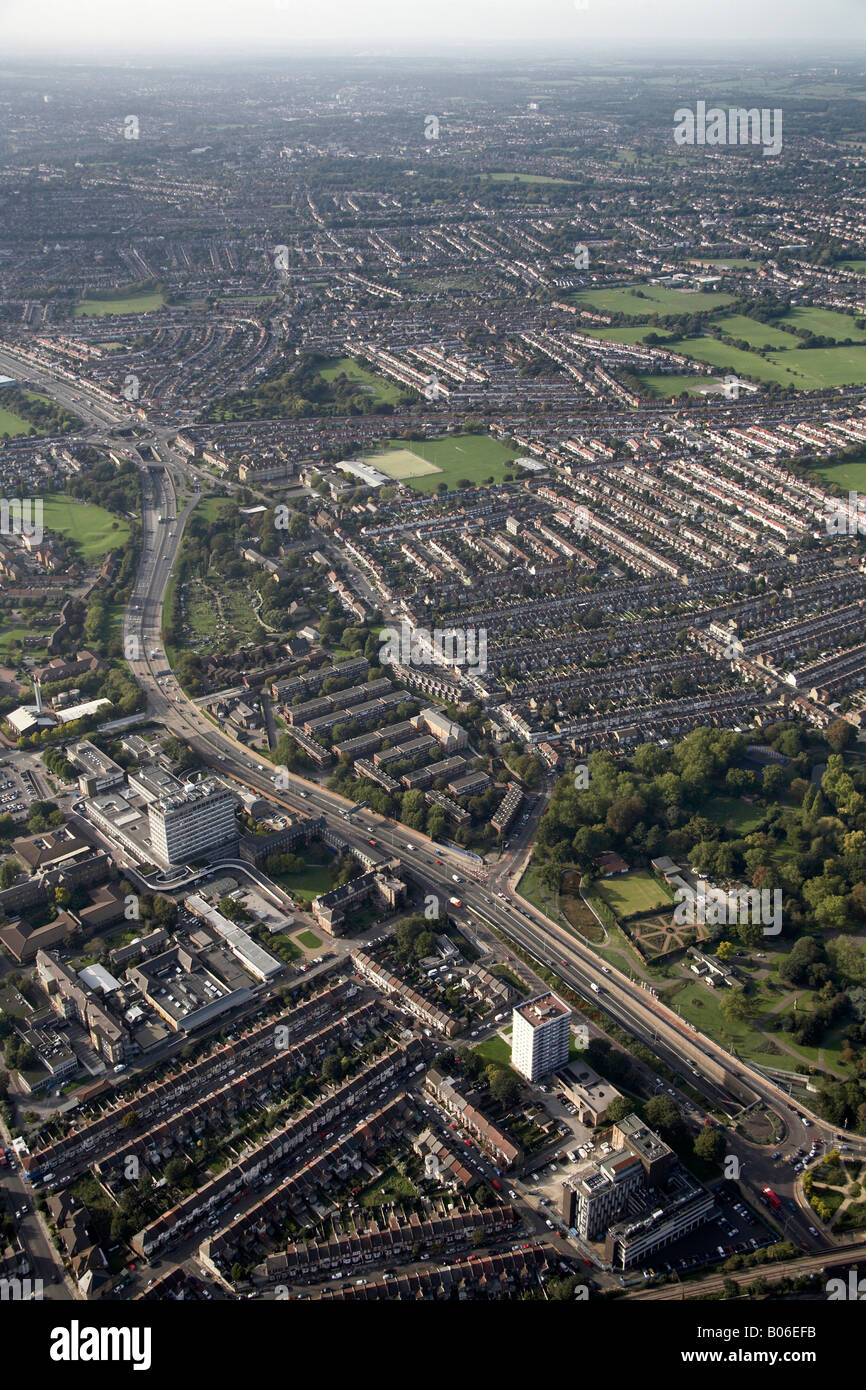 Aerial view north west of Sterling Way North Circular Road Great Cambridge Junction playing fields suburban houses - Stock Image