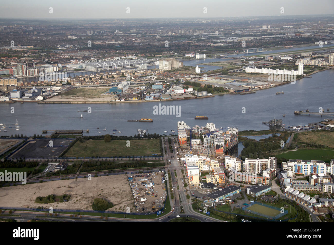 Aerial view north east of Greenwich Peninsula Ecology Park John Harrison Way River Thames Royal Victoria Dock London - Stock Image