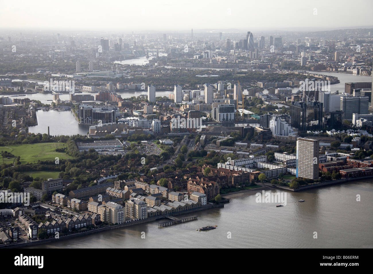 Aerial view north west of River Thames Millwall Outer Dock flats Cubitt Town Isle of Dogs Rotherhithe City of London Stock Photo