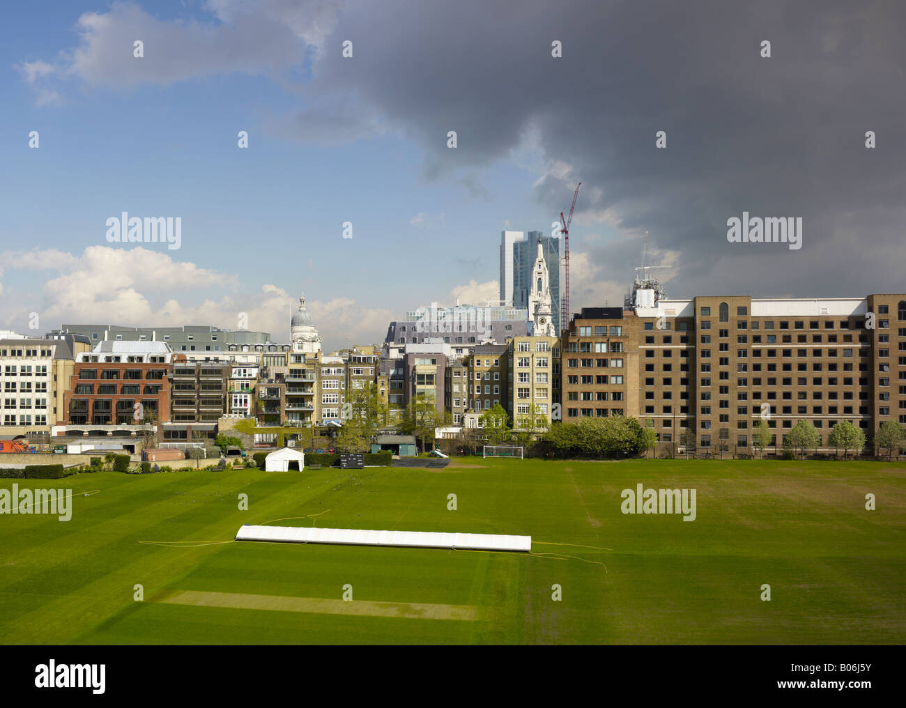 Bunhill Fields City of London showing the inner city green space on which sports are played View looking East - Stock Image