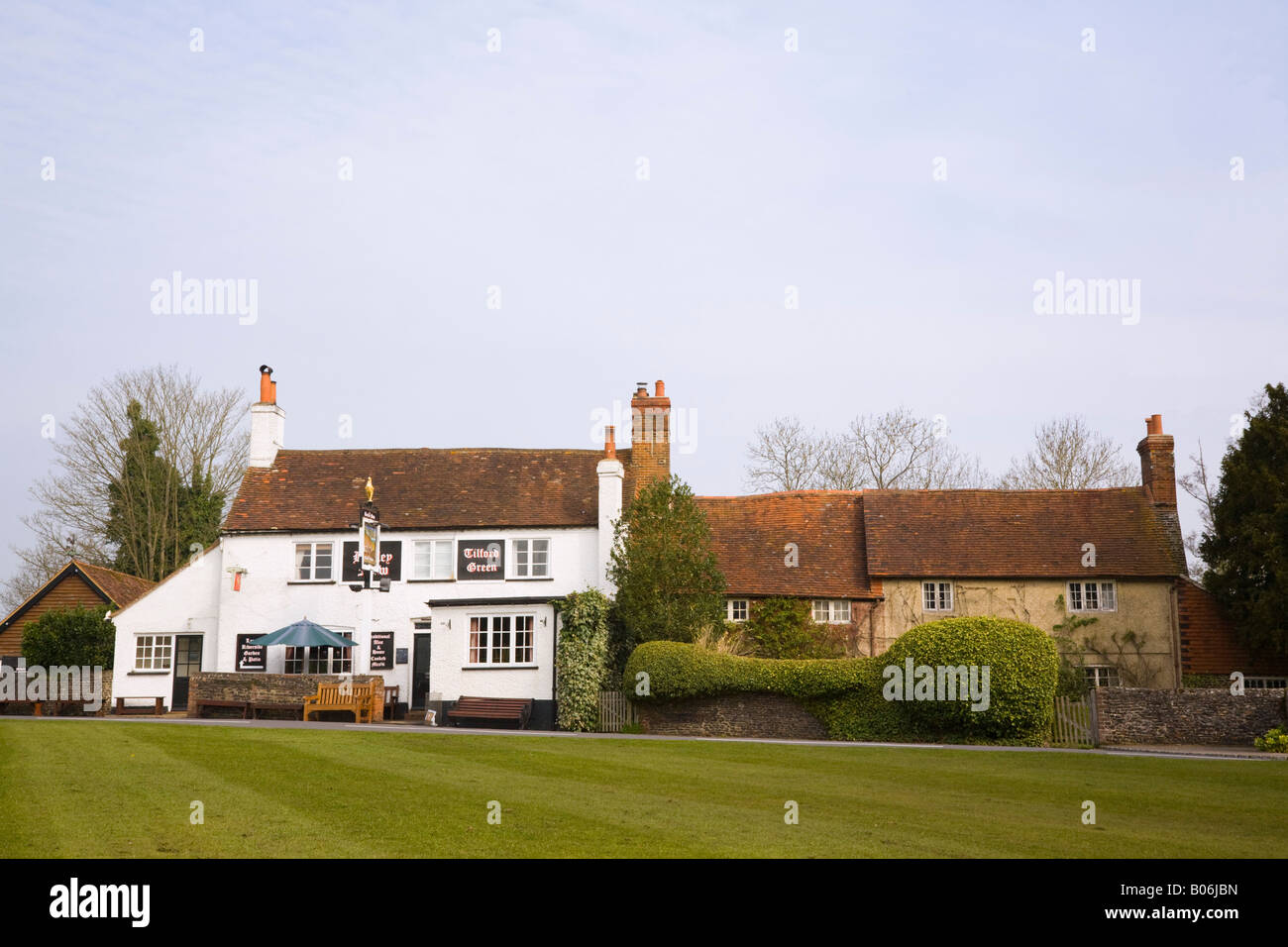 Tilford Surrey England UK. The Barley Mow traditional rural village pub overlooking village green - Stock Image