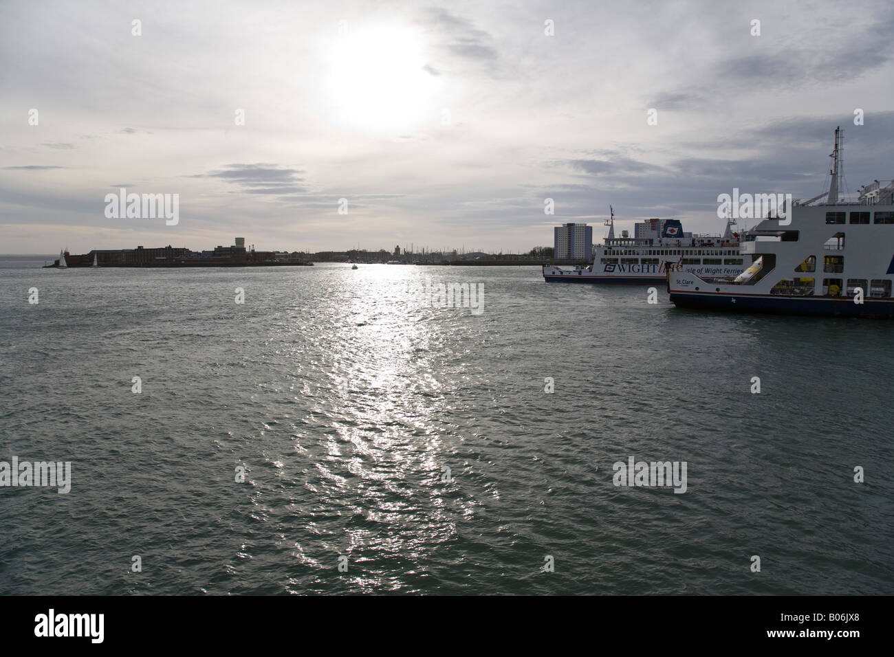 Two Isle of Wight ferries negotiate Portsmouth Harbour, late on a winter's afternoon, Porstmouth, Hampshire, England. Stock Photo