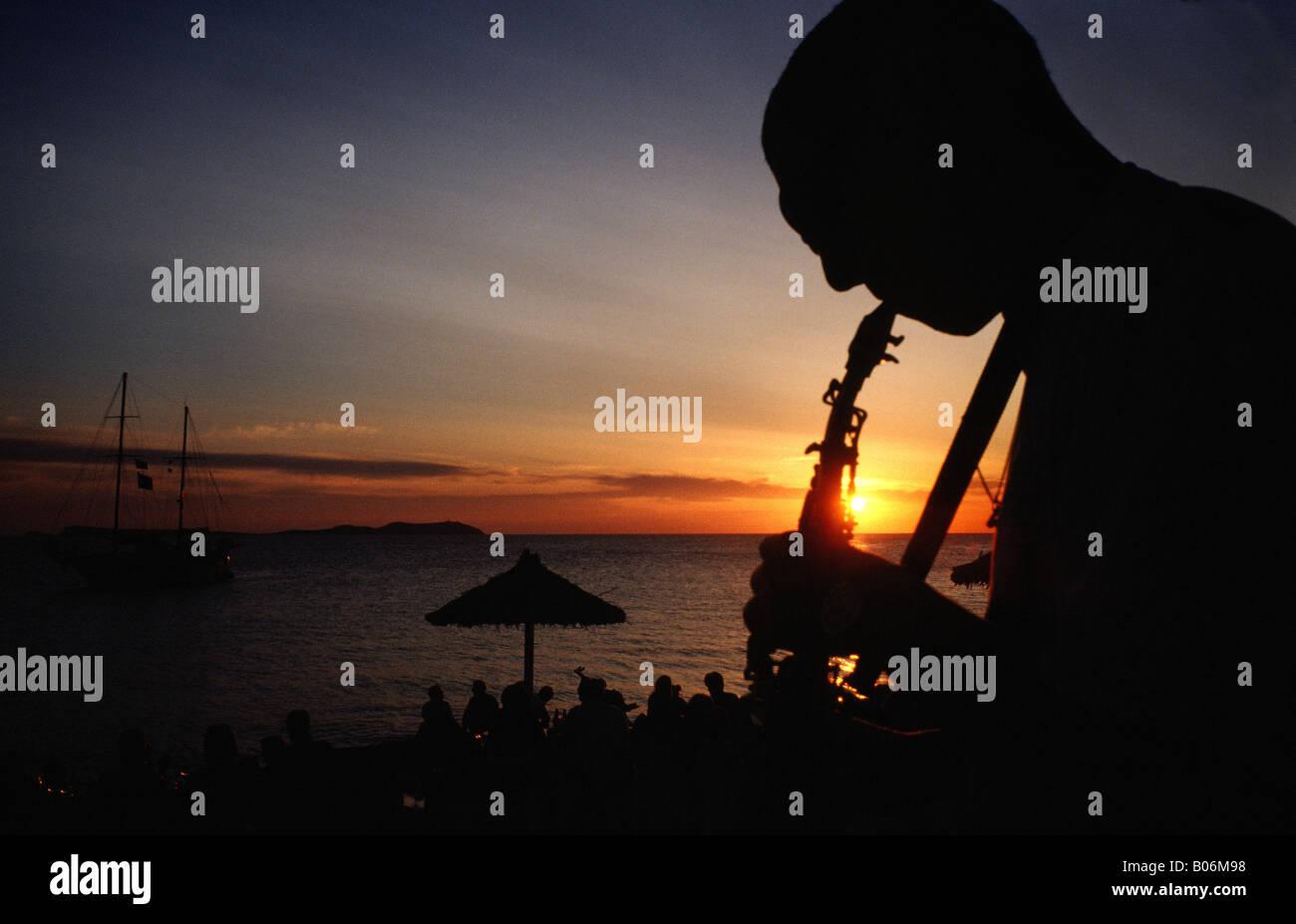 Man playing sax at Sunset Cafe del Mar Sant Antoni del Portmany Ibiza Balearic islands Spain - Stock Image