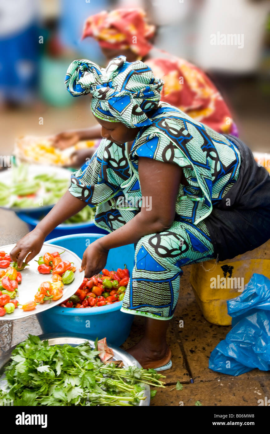 Gambian African woman selling chillis and peppers at the Albert Market, Banjul, Gambia, West Africa - Stock Image
