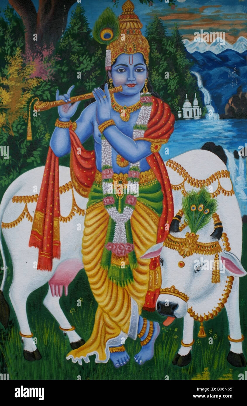 mural on hindu temple wall of krishna playing his flute with his pet B06N65