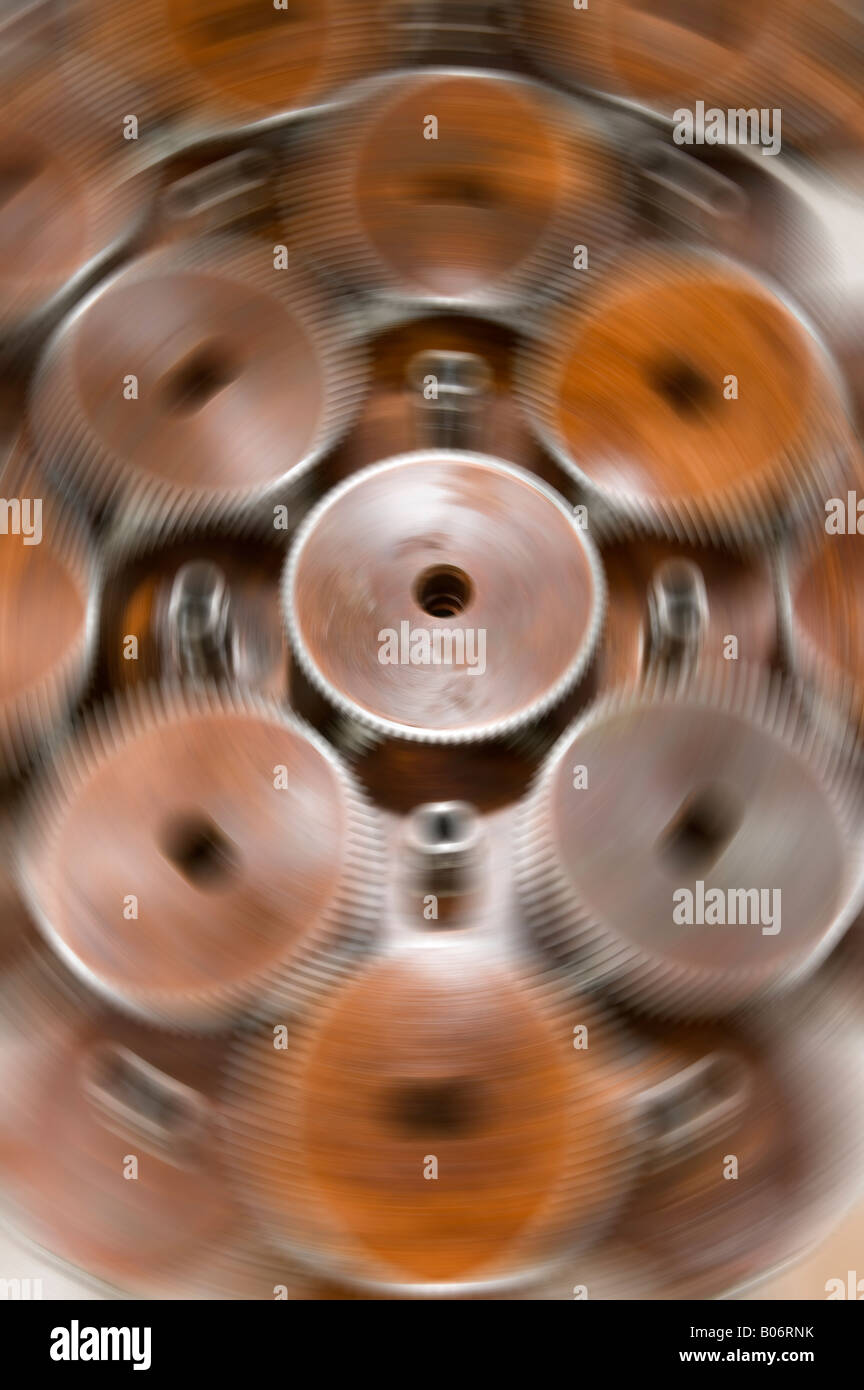Gears move around a stationary cog wheel with steel teeth - Stock Image