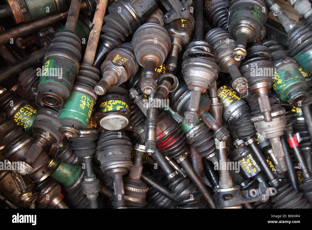horizontal color photograph of pile of discarded car parts - Stock Image