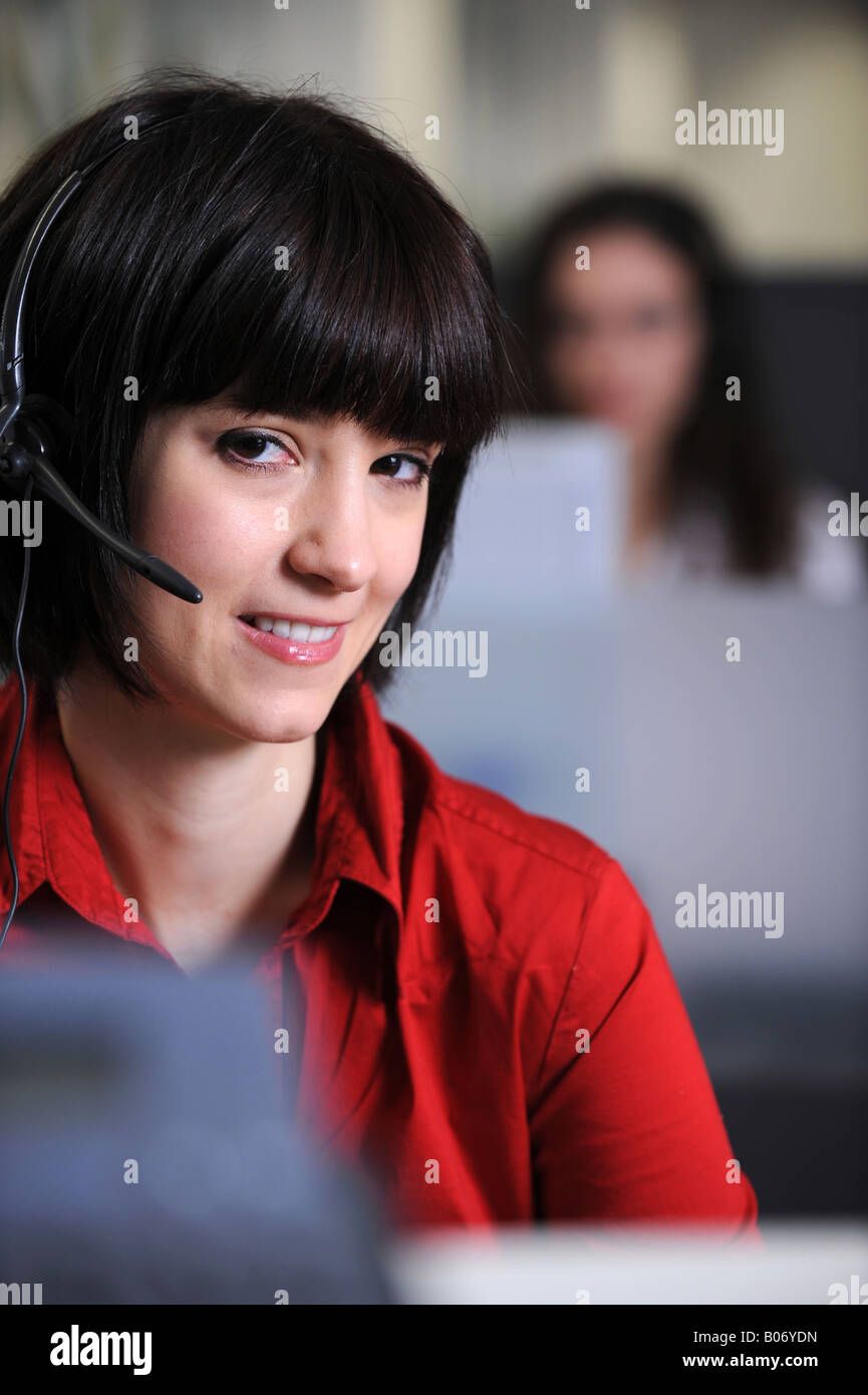 woman working in a call center - Stock Image