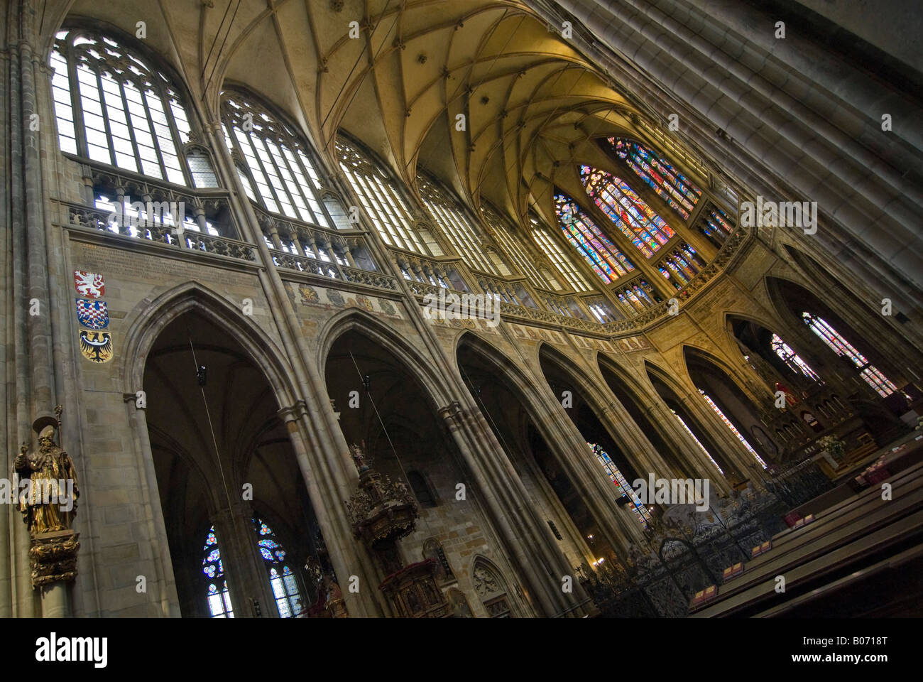 Horizontal abstract wide angle of the altar and vaulted ceiling inside St Vitus's Cathedral. Stock Photo