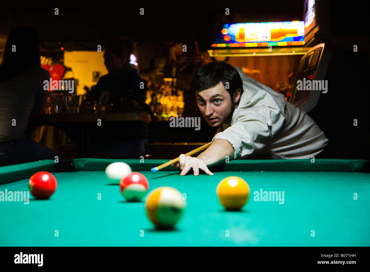 A patron takes aim during a round of 8 ball at the Knarr Tavern in Seattle s University District - Stock Image