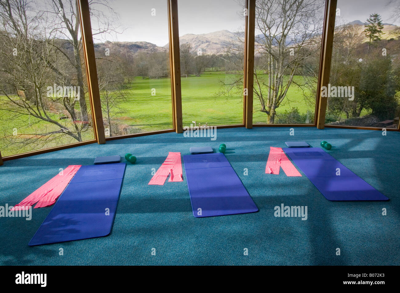 A village hall laid out for a pilates class overlooking the lake