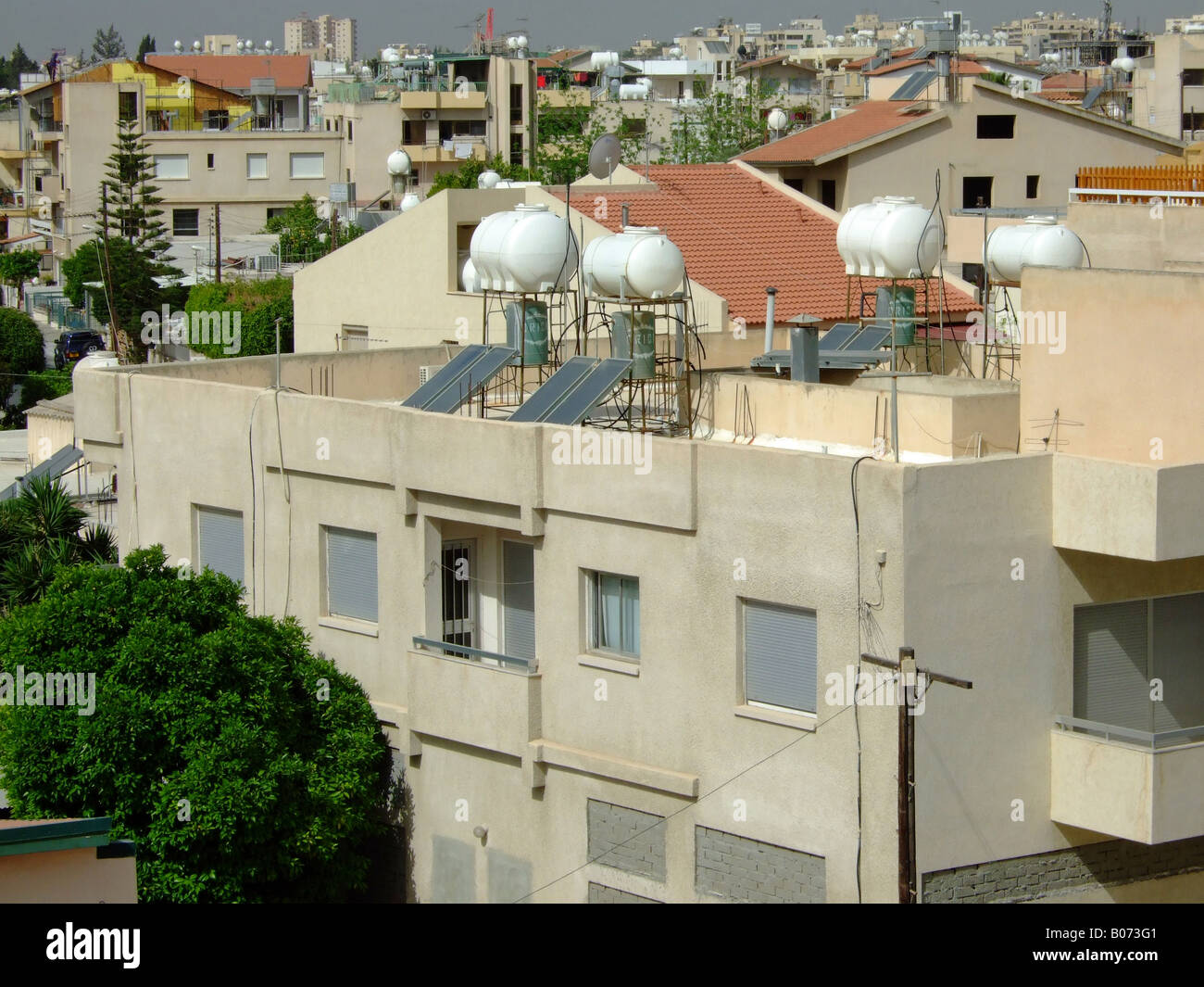 Domestic solar heated water supplies on rooftops. Limassol, Cyprus. - Stock Image