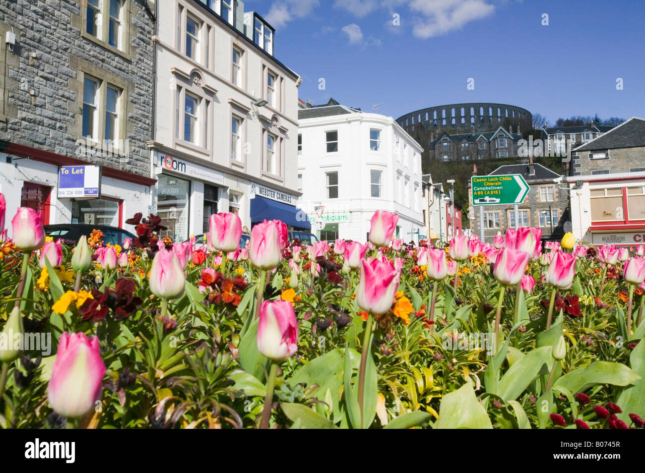 Oban town centre and McCaigs Tower on the west coast of Scotland - Stock Image