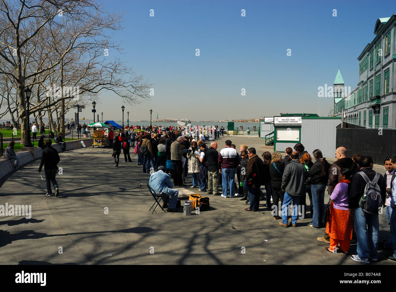 Tourists waiting in the line for the Liberty Island visit to see the Statue of Liberty, New York Stock Photo