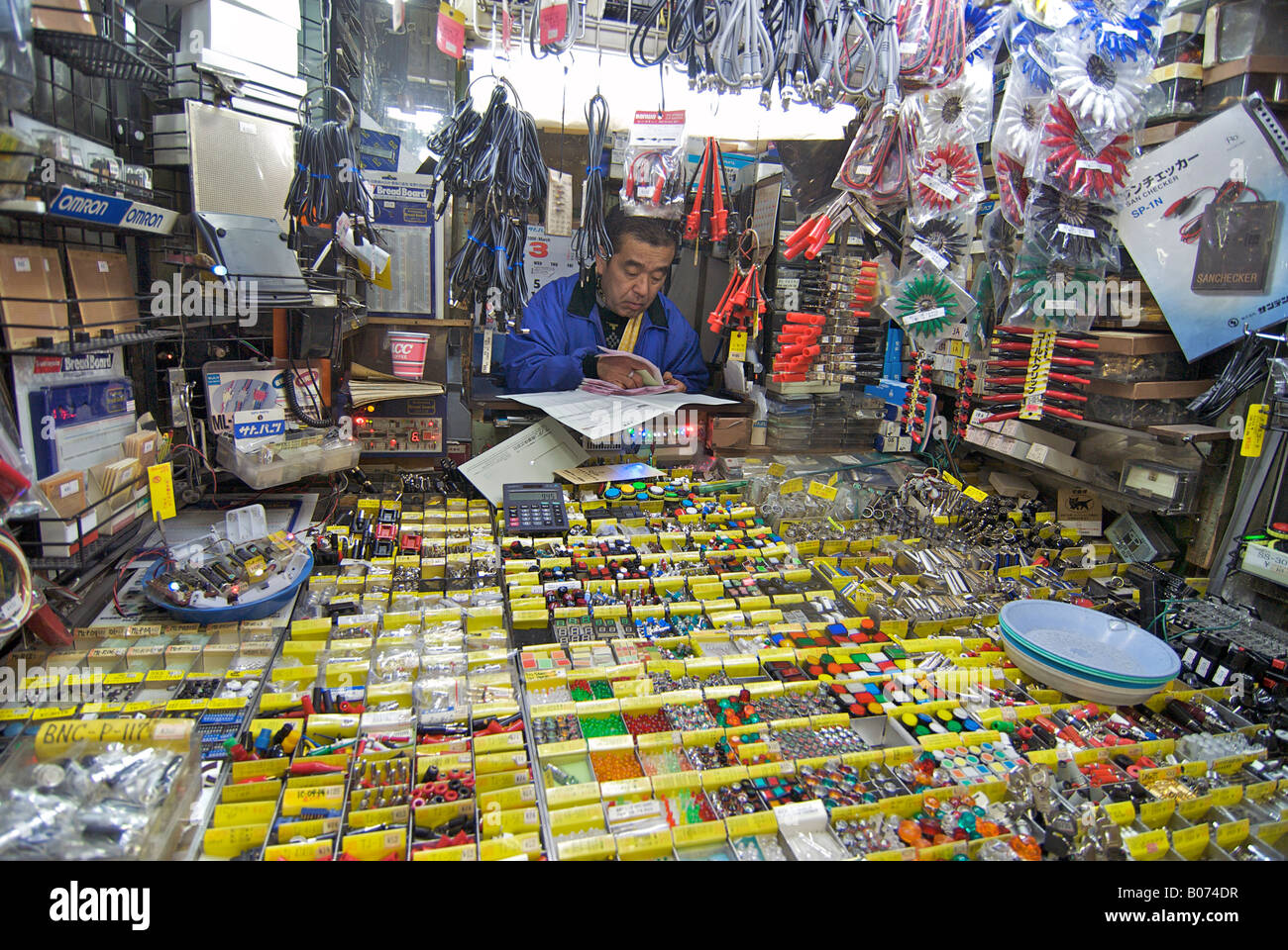 Small electronics component retailer in the market at Akihabara, ELECTRIC TOWN, Tokyo, Japan - Stock Image