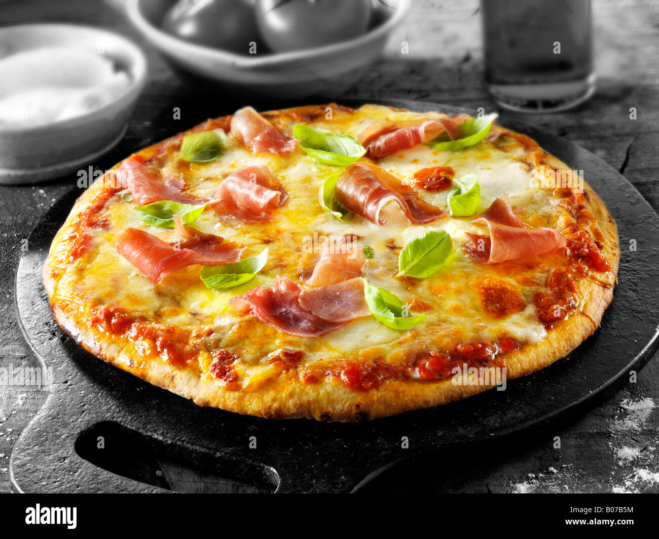 Pizza with procuitto ham - Stock Image