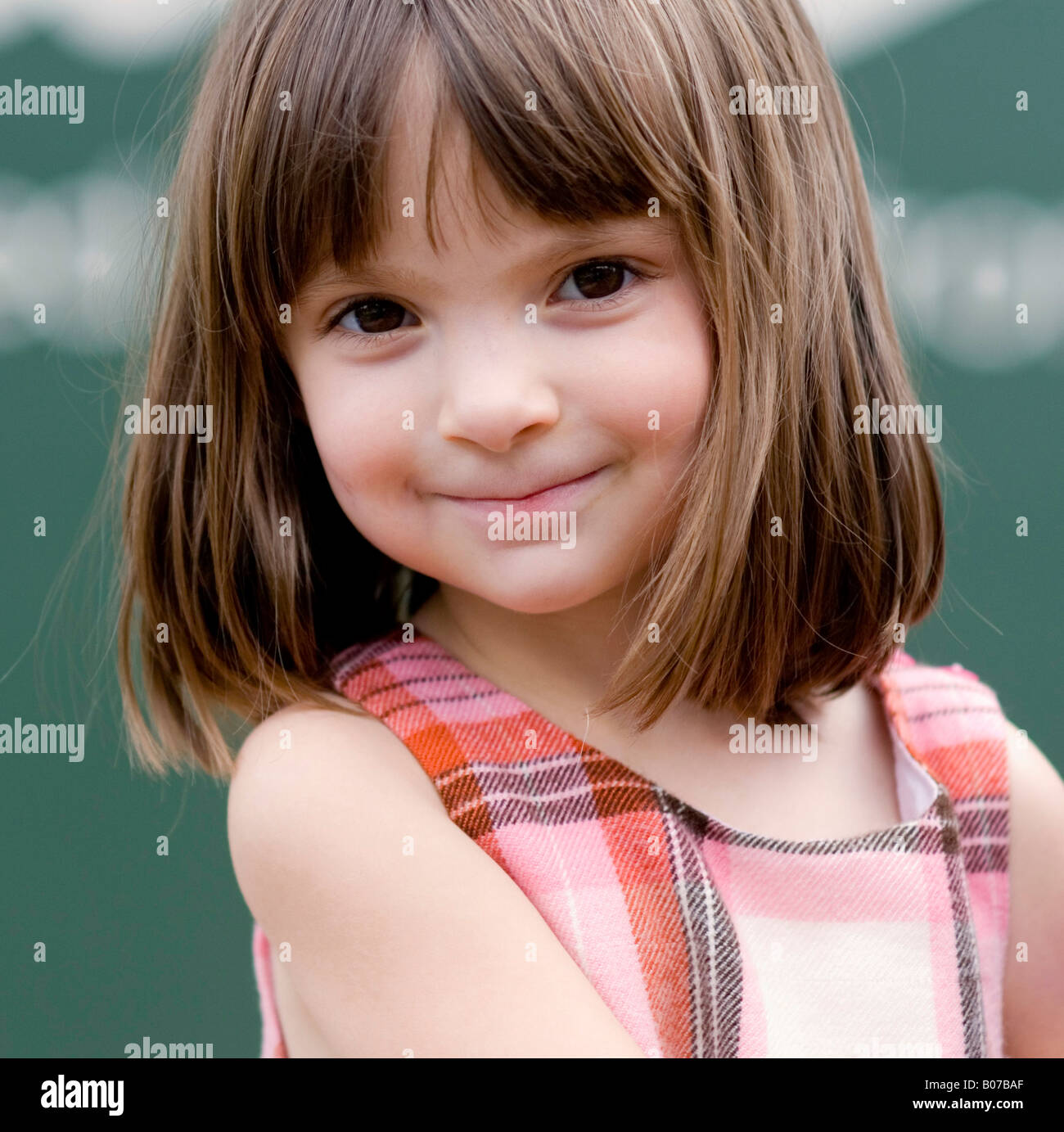 portrait of a pretty little girl with big brown eyes. Black Bedroom Furniture Sets. Home Design Ideas