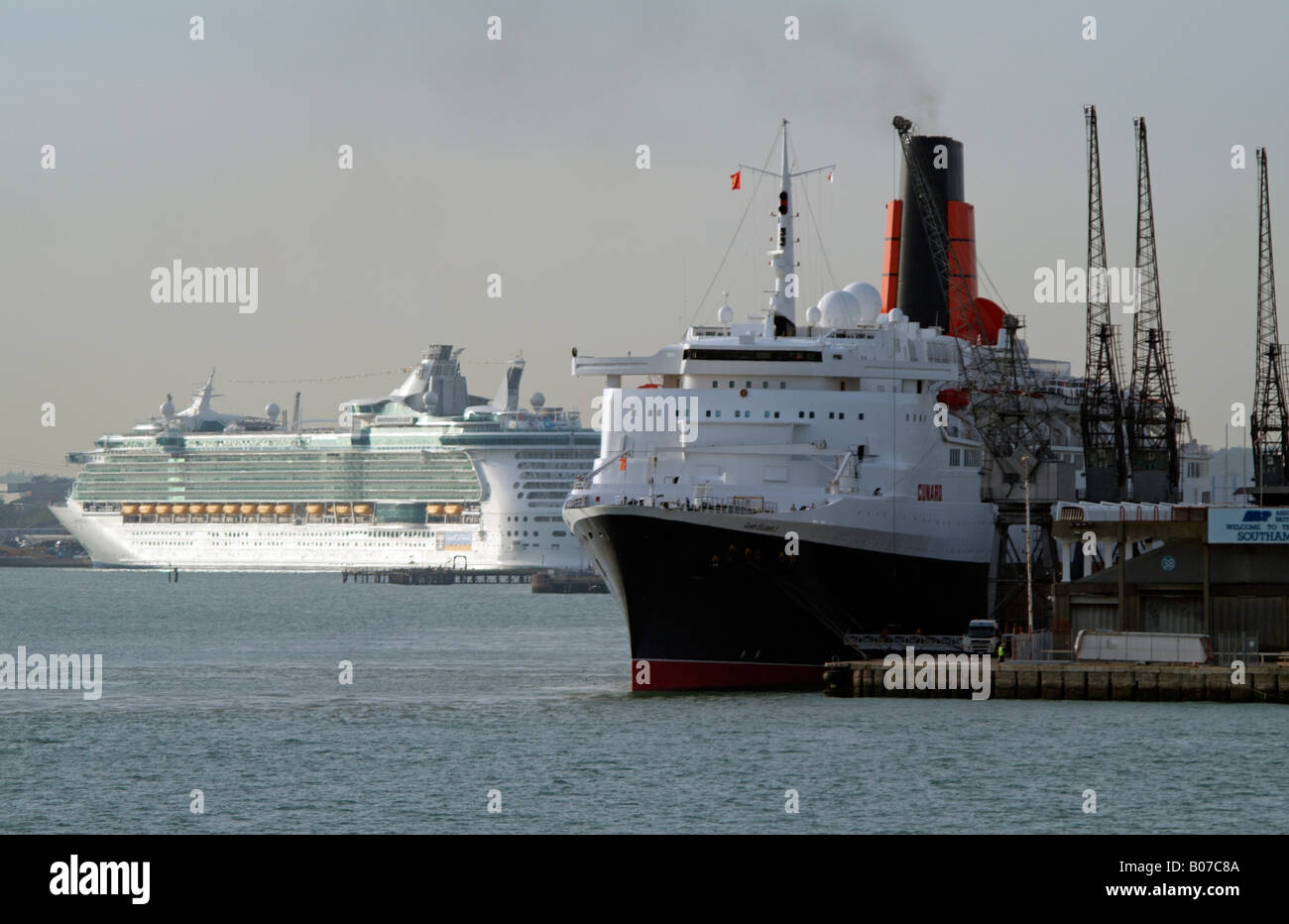 QE2 and Independence of the Seas Old and new Cruise ships Southampton - Stock Image
