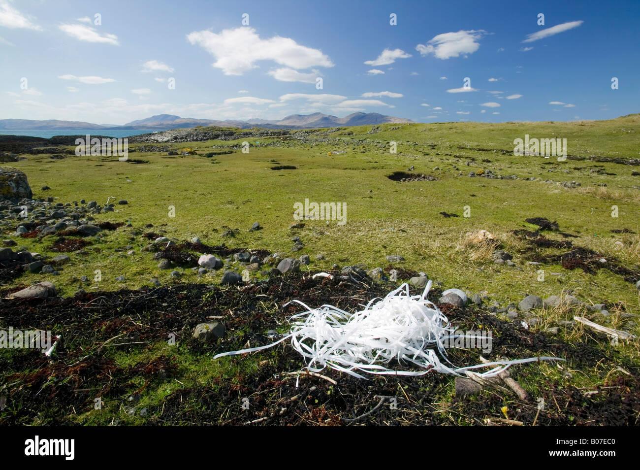Plastic waste washed ashore and blown inland on the isle of Kerrera off Oban Scotland UK - Stock Image