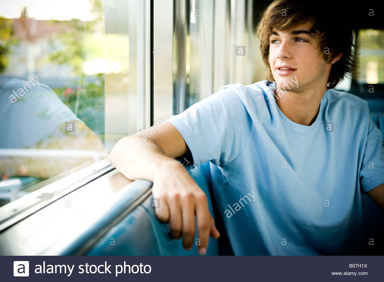 Portrait of a young man hanging out at a diner. - Stock Image