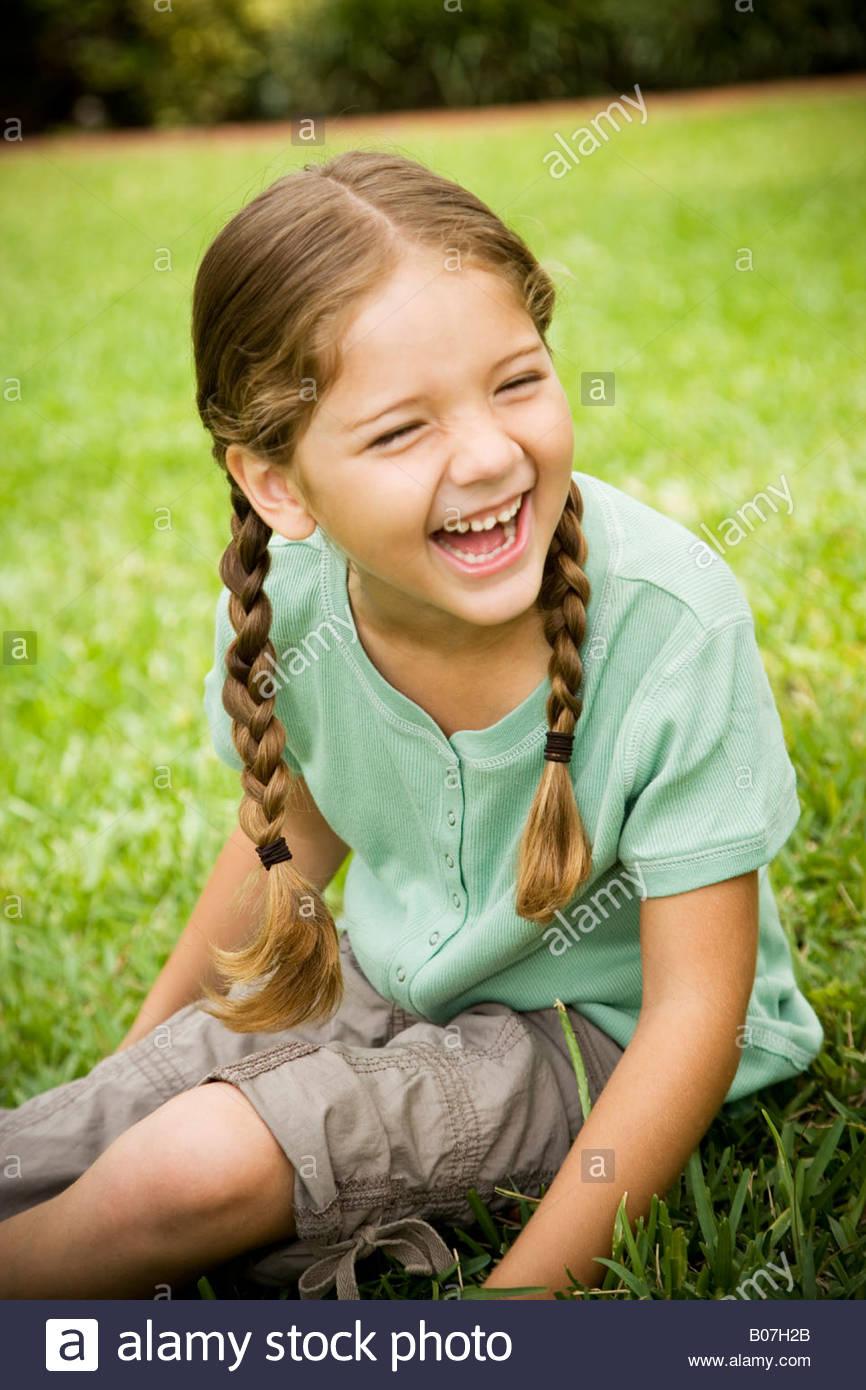 Little Girl Sitting On The Grass Stock Photos Amp Little