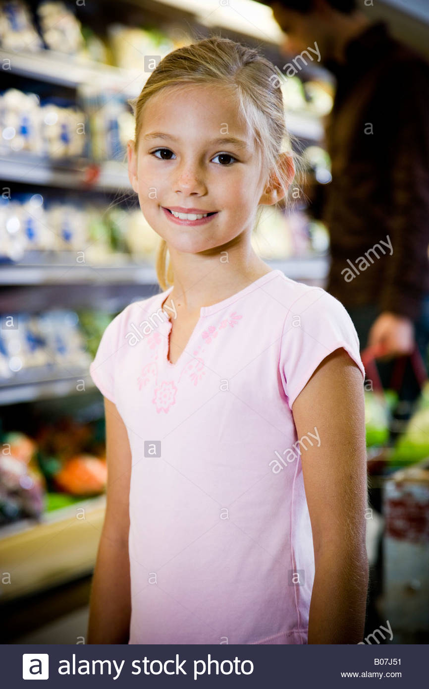 Portrait of a young girl at a supermarket. - Stock Image