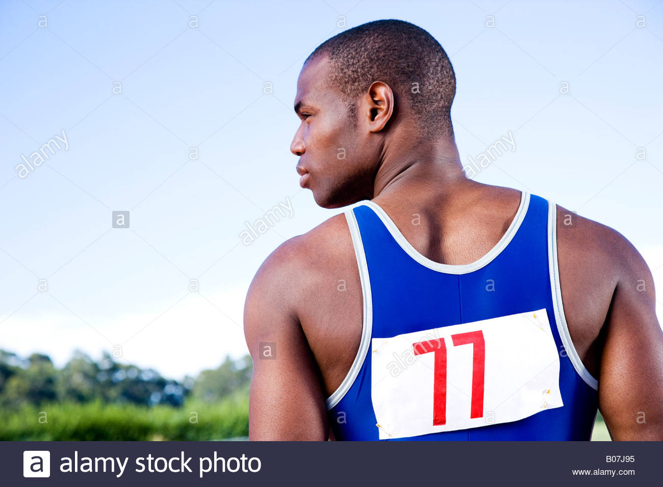 Rear view portrait of an athlete - Stock Image